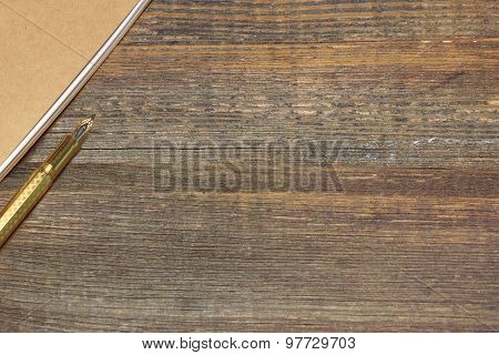 Notepad With Real Gold Fountain Pen On The Old Rough Wooden Table Background poster
