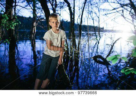 little boy on swamp