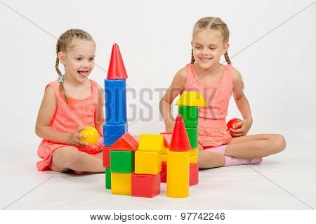 Two Girls Built A Castle Out Of Blocks