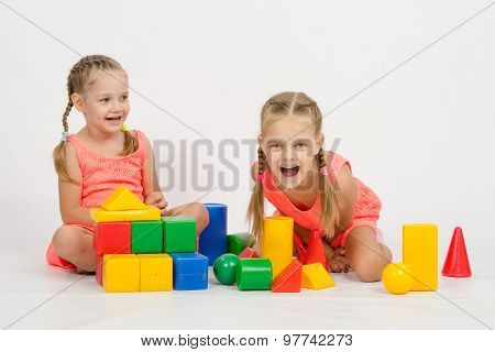 Two Girls Laughing Uncontrollably Playing Dice