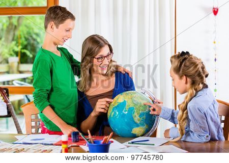 Homeschooling mother teaching kids private lessons in geography