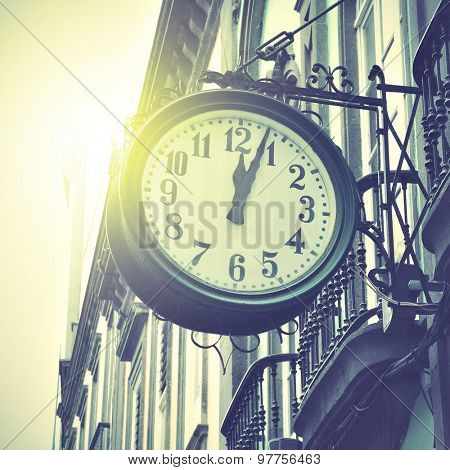 Old clock. Retro style filtred image