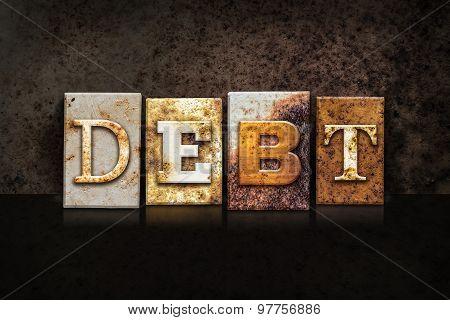 Debt Letterpress Concept On Dark Background