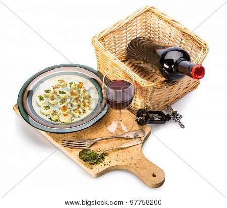 wine and cheese snack on wooden planch isolated on a white bakground