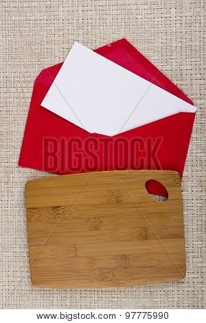 Cutting Board And Red Paper Envelope