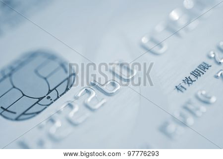 Close Up On The Microchip Of A Chinese Credit Card In Blue Tone, The Chinese Words Means Valid Date