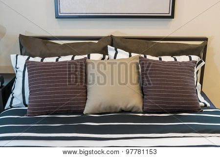 Modern Bedroom With Brown, Black And White Pillows