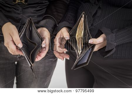 an empty wallet and a full of banknotes