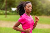 African american woman runner jogging outdoors - Fitness people and healthy lifestyle poster