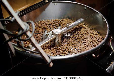 Coffee beans in roaster, closeup