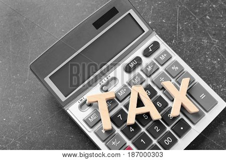 Word TAX and calculator on table