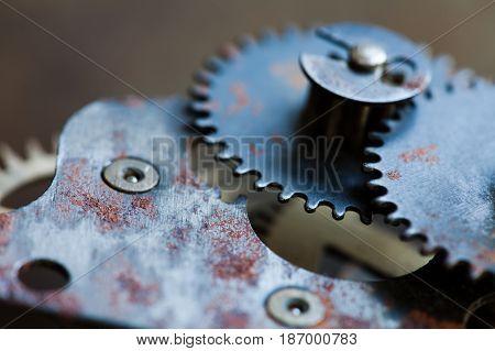 Cogs wheels machinery, rusty iron mechanism. Black metal gears close-up photo. Shallow depth field. Selective focus
