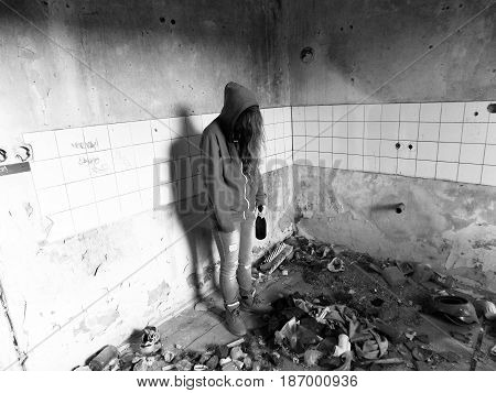 Young alcohollic woman with alcohol bottle, alcohol addiction