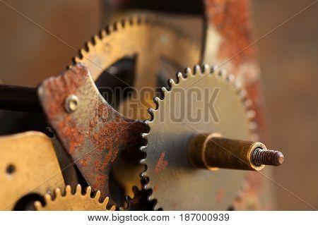 Rusty textured cog gears engineering mechanism macro view. Black metallic wheel close-up photo. Shallow depth field. Selective focus