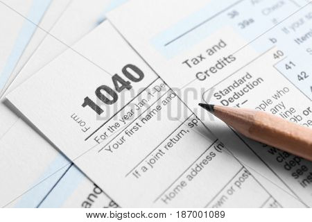 Individual Tax Return Forms and pencil on table