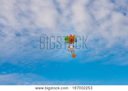 A balloon stork figure flying in the cloudy sky