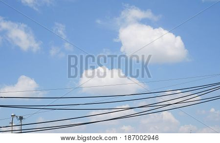 Electric wire with blue sky. Transmission Line cables. Electric wire in the sky background.