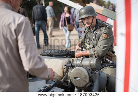 01 October 2016. A historical reenactment of the Wars History in Kiev, Ukraine. A German soldier on a military motorsycle.