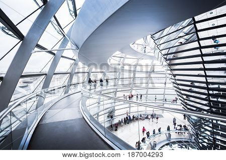 BERLIN - JULY 19: Interior view of famous Reichstag Dome on July 19 2015 in Berlin Germany. Constructed to symbolize the reunification of Germany it's now one of Berlin's most important landmarks.