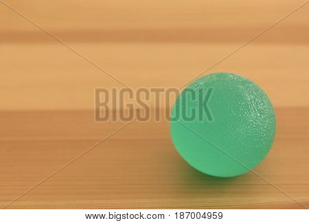 Rubber ball on light wooden background