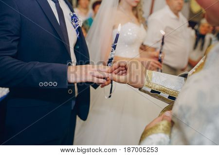 beautiful young couple takes a wedding in the Church