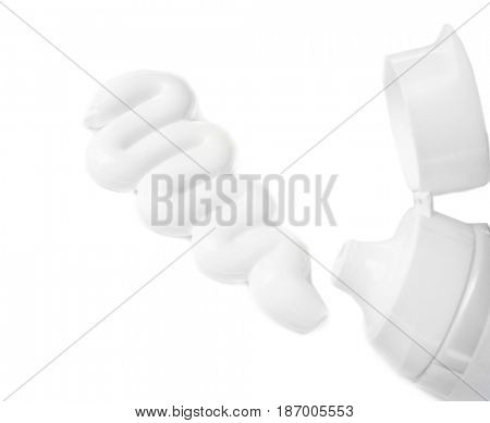 Tube with toothpaste on white background