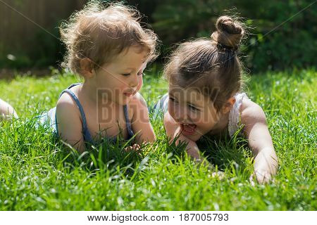 Little Girls Playing Outdoors