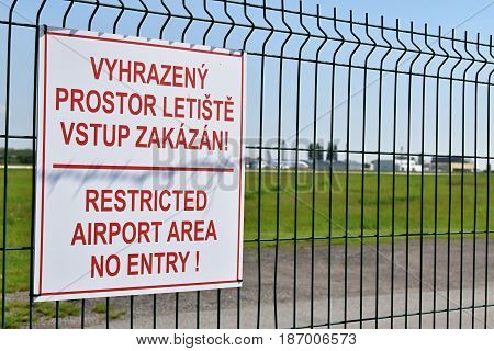 Sign with the name Restricted airport area no entry.