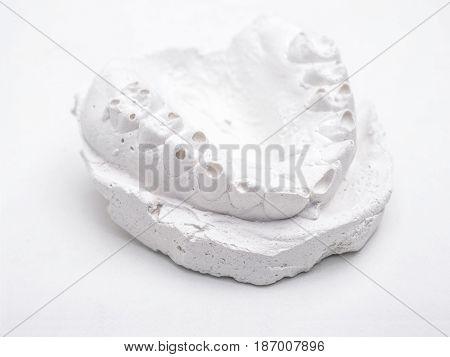 dentist gypsum impression of human jaw isolated on white background