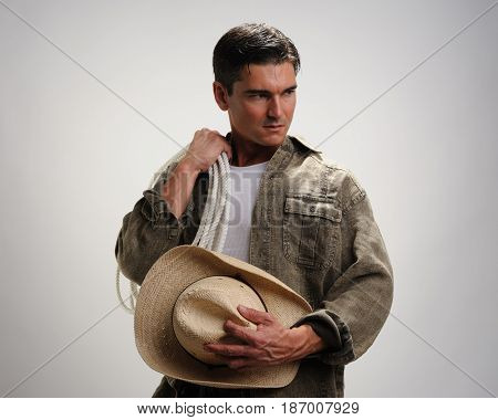 The handsome cowboy is waiting with desire.