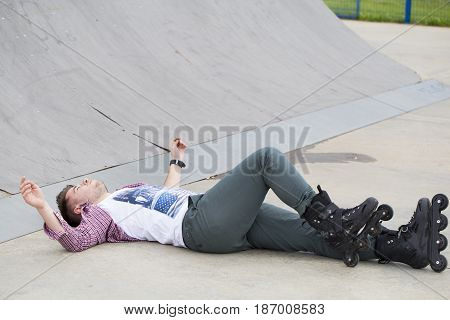 Young Man On Roller Skates Had An Accident, He Fell Down And Hurt The