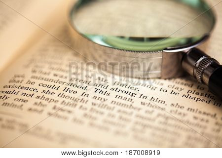 Magnifying glass loupe zoom magnifier book open book text