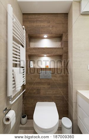 Interior of a small bathroom with towel warmer