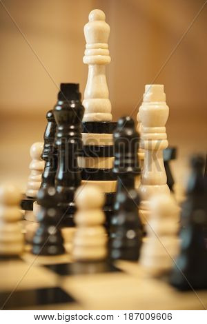 Composition of chess pieces and checkers. Soft focus.