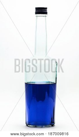 Blue alcohol bottle isolated on white. A half-filled bottle of blue alcohol.