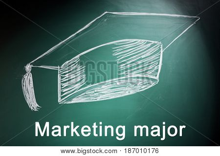 Marketing major concept. Drawing of graduation cap on blackboard