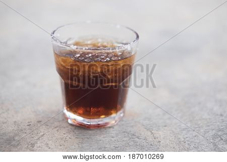 A glass of cola with ice for Cool off in the summer