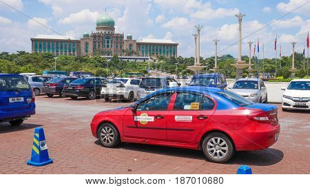 KUALA LUMPUR MALAYSIA - MAR 22 2017: Taxi service for tourist in front of the famous place for group tourist. Perdana Putra building the office of Prime Minister Malaysia in Kualum Lumpure Malaysia.