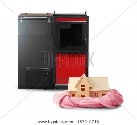 Toy house with solid fuel boiler on white background. Energy savings concept