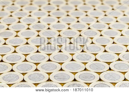 Close up of British money new pound coins neat background. The bimetallic coin was introduced in March 2017. These coins are dated 2016.