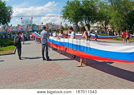 Volgograd Russia - June 12 2011: Activists hold a large Russian flag on the Independence day of Russia in Volgograd