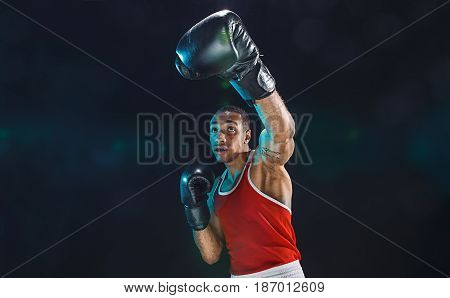 Afro american male boxer. Young man boxing workout in a fitness club. Muscular strong man on background black studio