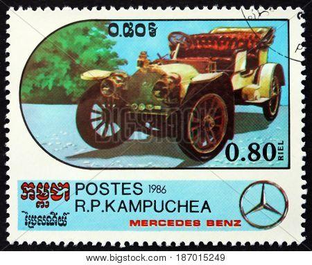 CAMBODIA - CIRCA 1986: a stamp printed in Cambodia shows 1907 Open Touring Car Mercedes-Benz Automobile circa 1986
