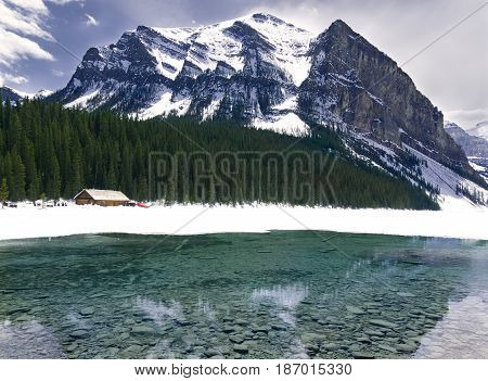 Turquoise Lake Louise Thawing in the Spring with Mountain Backdrop