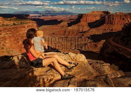 A mother and her baby son visit Canyonlands National park in Utah USA