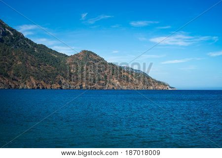 Calm blue sea and sky. Travel background. Summer vacation holiday.