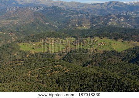 The forest gives way to a clearing from Pedró de Tubau
