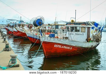 PUNTA DEL ESTE - URUGUAY, MARCH 3, 2017: Colorful fishing boats are lined up at the dock of the popular resort city on the Atlantic coast.