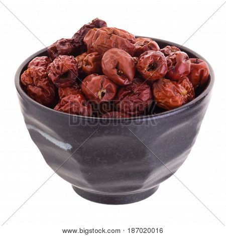 Dried Jujube Fruits In Ceramic Bowl Chinese Herbal Medicine On A White Background