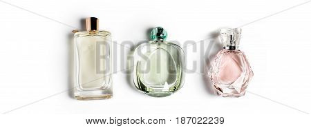 Perfume bottles on light background. Perfumery, cosmetics, fragrance collection. Banner for website